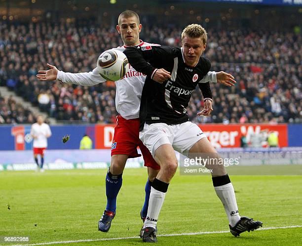 Mladen Petric of Hamburg and Maik Franz of Frankfurt battle for the ball during the Bundesliga match between Hamburger SV and Eintracht Frankfurt at...