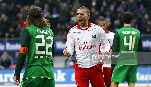 Mladen Petric of Hamburg celebrates after he scores his team's opening goal during the Bundesliga match between Hamburger SV and SV Werder Bremen at...