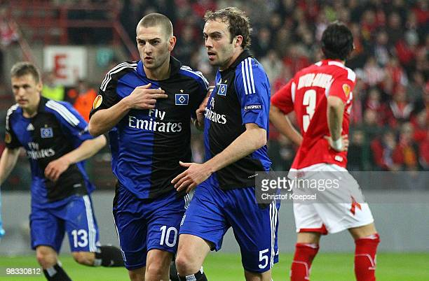 Mladen Petric of Hamburg celebrates the first goal with Joris Mathijsen of Hamburg during the UEFA Europa League quarter final second leg match...