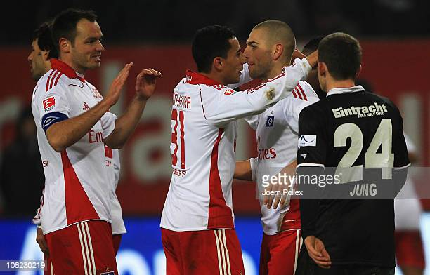 Mladen Petric of Hamburg celebrates with his team mates after scoring his team's first goal during the Bundesliga match between Hamburger SV and...