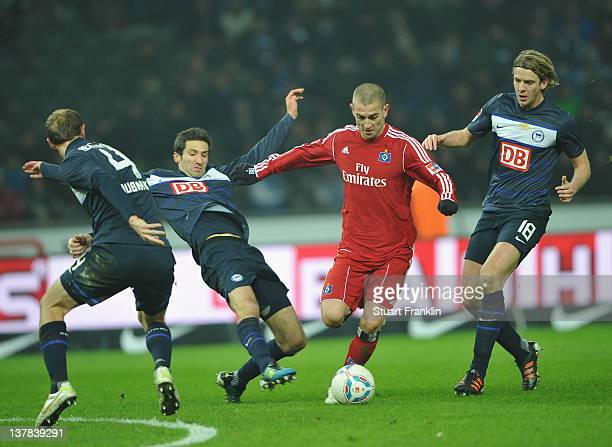 Mladen Petric of Hamburg is challenged by Andre Mijatovic and Peter Niemeyer of Berlin during the Bundesliga match between Hertha BSC Berlin and...