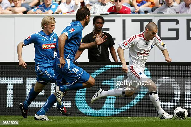 Mladen Petric of Hamburg is challenged by Josip Simunic and Andreas Beck of Hoffenheim during the Bundesliga match between 1899 Hoffenheim and...