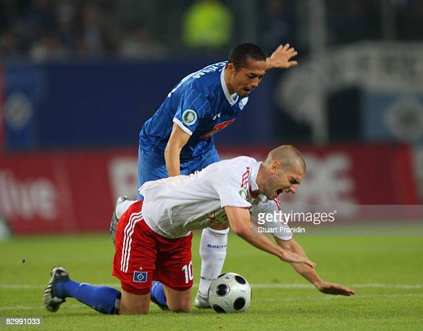Mladen Petric of Hamburg is challenged by Shinji Ono of Bochum during the DFB Cup Second Round match between Hamburger SV and VfL Bochum at the HSH...