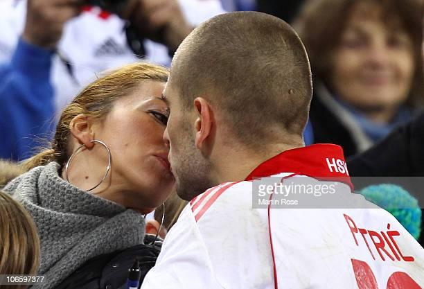 Mladen Petric of Hamburg kisses his wife Despina after the Bundesliga match between Hamburger SV and 1899 Hoffenheim at Imtech Arena on November 6...