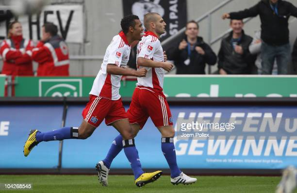 Mladen Petric of Hamburger SV celebrates with his team mate EricMaxim Choupo Moting after scoring his team's first goal during the Bundesliga match...