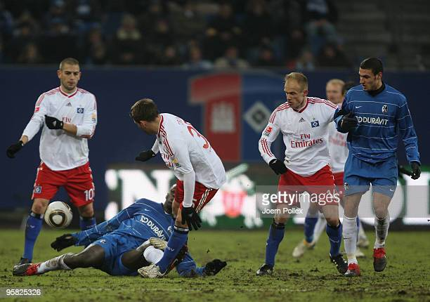 Mladen Petric Tunay Torun and David Jarolim of Hamburg and Jackson Mendy and Ömer Toprak battle for the ball during the Bundesliga match between...