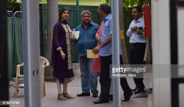 MLAs Alka Lamba Adarsh Shastri with others coming out after the Aam Aadmi Party MLAs meeting at Delhi CM Arvind Kejriwal House on May 6 2017 in New...