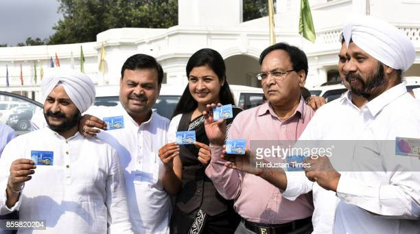 AAP MLAs Naresh Kumar Jarneal Singh Alka Lamba Anil Bajpai Ajay Dutt Jagdeep Singh show their metro cards when they arrived to attend the special...
