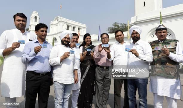AAP MLAs Rituraj Naresh Kumar Jarneal Singh Alka Lamba Anil Bajpai Ajay Dutt Jagdeep Singh Commando Surinder Kumar show their metro card when they...
