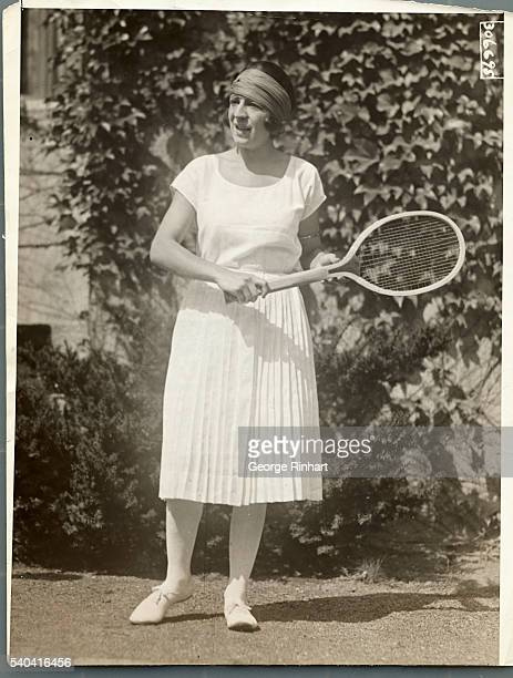 Mlle. Lenglen, the French tennis marvel, takes her favorite pose for the camerman on the west side courts at Forest Hills, L.I. Today, where she...