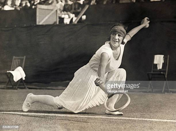 Mlle. Suzanne Lenglen, France's foremost tennis player, shown in unusual action today on the west side tennis courts at Forest Hill, L.I. Where...