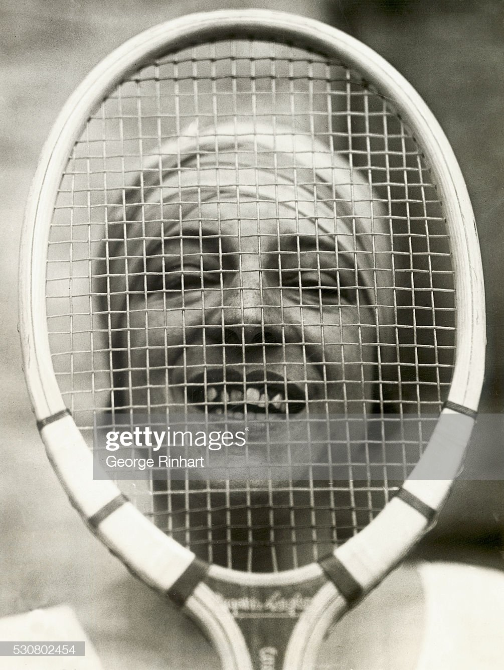 Suzanne Lenglen Looking Through Her Racquet : News Photo