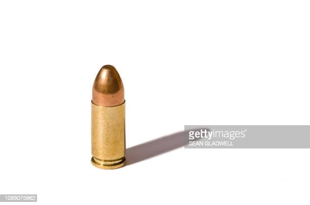 9 mm bullet - bullet stock photos and pictures