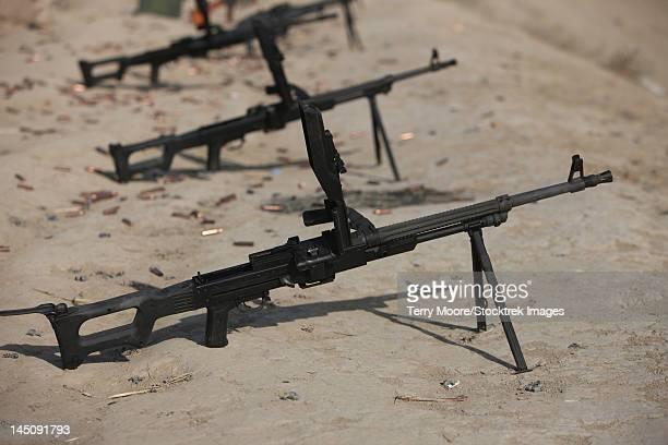 pk 7.62 mm general-purpose machine guns stand ready on a firing range in kunduz, afghanistan. - mitragliatrice foto e immagini stock