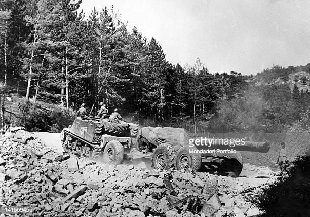 A 203 mm howitzer being pulled by a US tracked vehicle along the Ubends of the Passo della Futa on the Italian front Tuscany September 1944