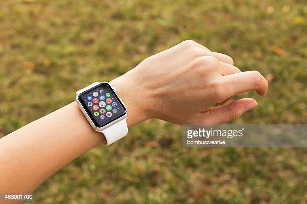 apple watch 42 mm stainless steel with white sport band - wrist watch stock pictures, royalty-free photos & images