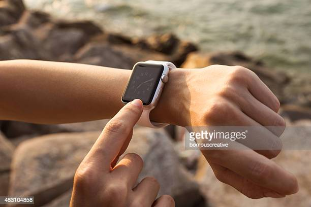 apple watch 42 mm stainless steel with white sport band - apple watch stock pictures, royalty-free photos & images