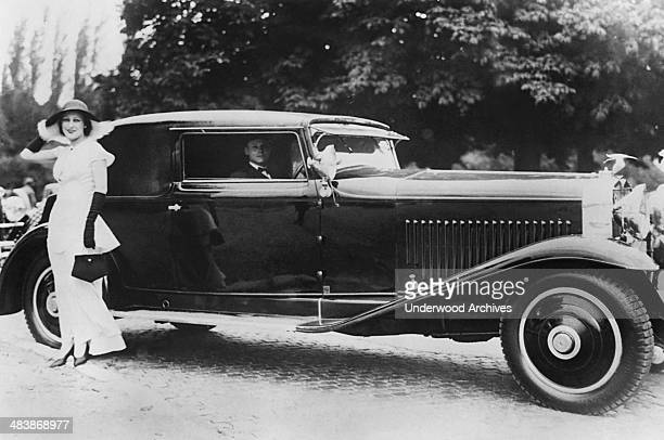 MMe Coste wife of Dieudonne Coste noted French aviator with her entry in the recent International Auto Show Paris France late 1920s