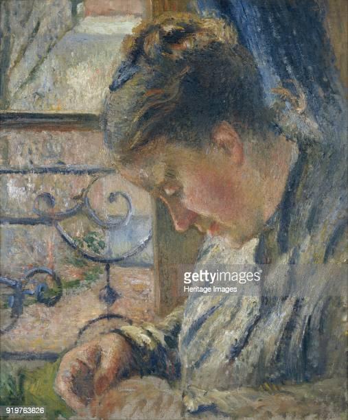 Mme Pissarro sewing beside a Window circa 1877 Artist Camille Pissarro
