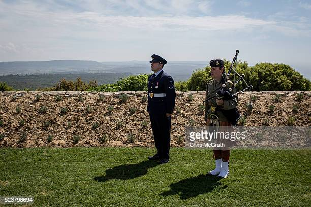 Mmebers of an Australian Navy band stand at attention during the playing of the Last Post at the Lone Pine Cemetery and memorial on April 24, 2016 in...