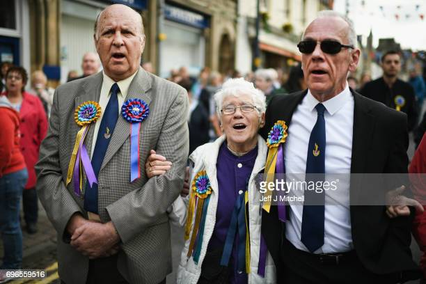 Mmebers of the public sing during the towns Common Riding one of the oldest Borders festivals June 16 2017 in Selkirk Scotland The event dating from...