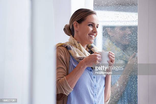 mmm, hot coffee on a rainy day..such bliss! - hot tea stock pictures, royalty-free photos & images