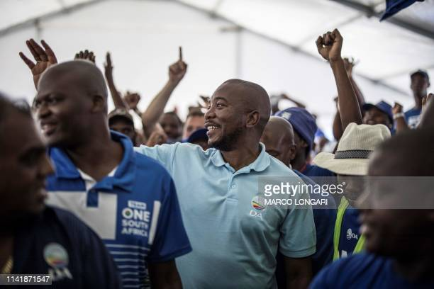 Mmusi Maimane, the leader of South African opposition party Democratic Alliance is welcomed by supporters at a gathering in the Durban township of...