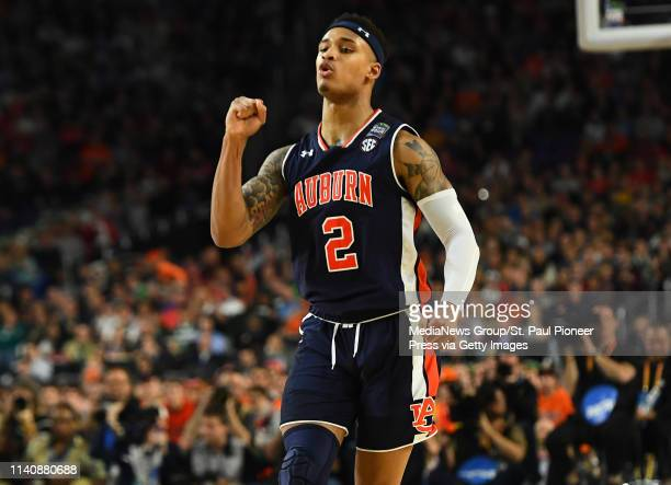 Auburn guard Bryce Brown reacts after hitting a three point shot against Virginia in the second half of a semifinal game of the NCAA Final Four men's...