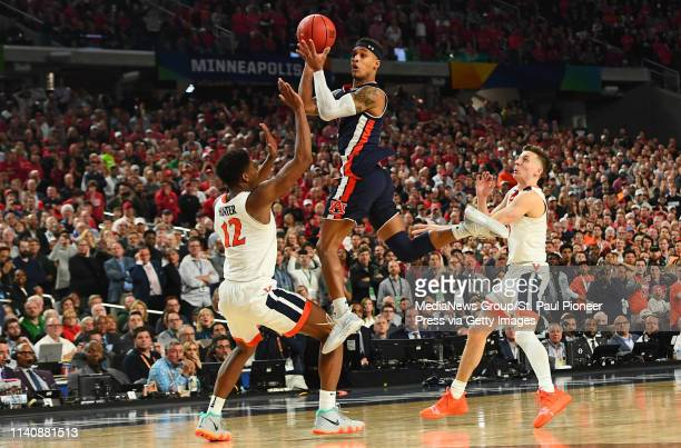 Auburn guard Bryce Brown spins to shoot a shot with less than a second left on the clock against Virginia in the second half of a semifinal game of...