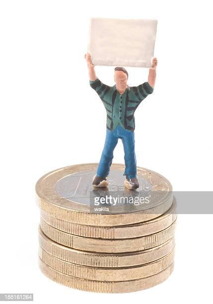 Männchen mit Plakat auf Euromünzen
