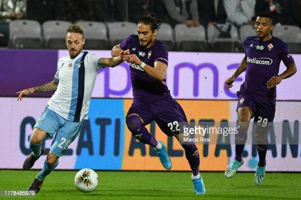 Mnuel Lazzari of SS Lazio compete for the ball with Martin Caceres of Fiorentina ACF during the Serie A match between ACF Fiorentina and SS Lazio at...
