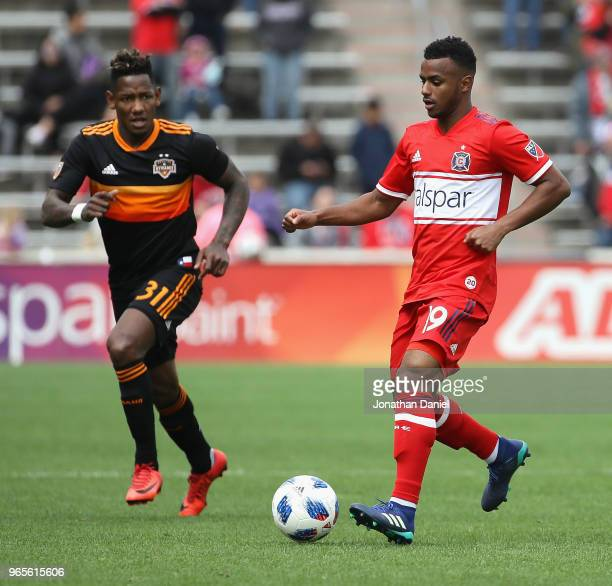 Mo Adams of the Chicago Fire controls the ball near Romell Quioto of the Houston Dynamo at Toyota Park on May 20 2018 in Bridgeview Illinois The...