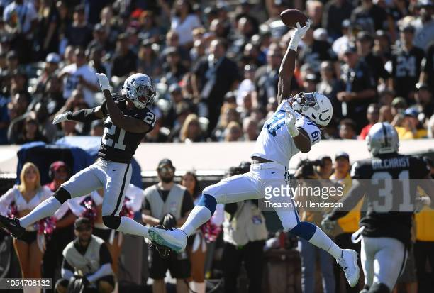 Mo Alie-Cox of the Indianapolis Colts makes one handed catch for a 26 yard touchdown play over Gareon Conley of the Oakland Raiders during the first...