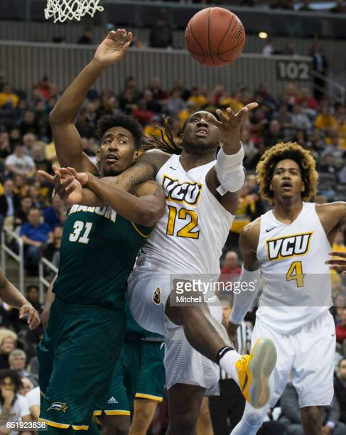 Mo AlieCox of the Virginia Commonwealth Rams and Jalen Jenkins of the George Mason Patriots fight for the ball in the Quarterfinals of the men's...