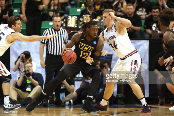 Mo AlieCox of the Virginia Commonwealth Rams is defended by Jock Landale of the St Mary's Gaels during the first round of the 2017 NCAA Men's...