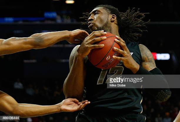 Mo AlieCox of the Virginia Commonwealth Rams plays the ball against Dayton Flyers during the Atlantic 10 Basketball Tournament Championship game at...