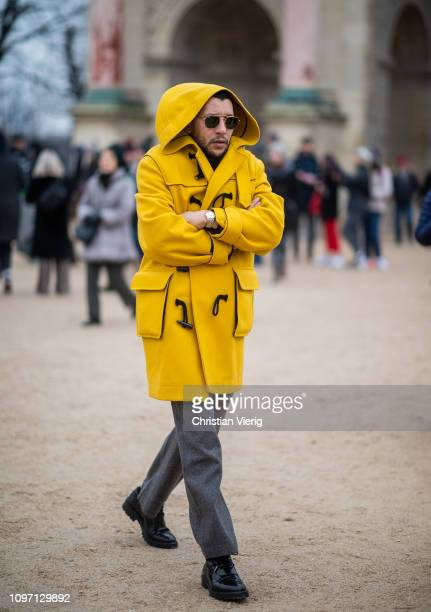 Mo Anwar is seen wearing yellow hooded coat outside Kenzo during Paris Fashion Week Menswear F/W 20192020 Day Six on January 20 2019 in Paris France