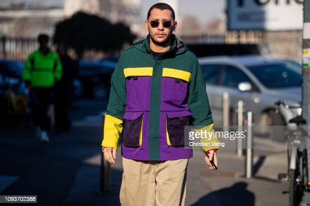 Mo Anwar wearing windbeaker is seen outside MSGM during Milan Menswear Fashion Week Autumn/Winter 2019/20 on January 13 2019 in Milan Italy