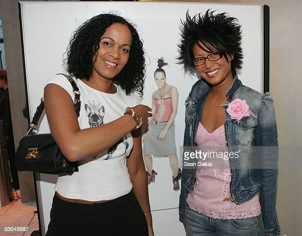 Mo Asumang and pianist Ming stand next to a portrait of Asumang at the Prominence for Charity Benefit Gala June 9 2005 in Berlin Germany The evening...