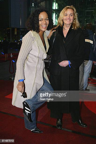 Mo Asumang arrives with a broken heal at the German premiere to The Bourne Supremacy at the CineStar at the Sony Center on October 16 2004 in Berlin...