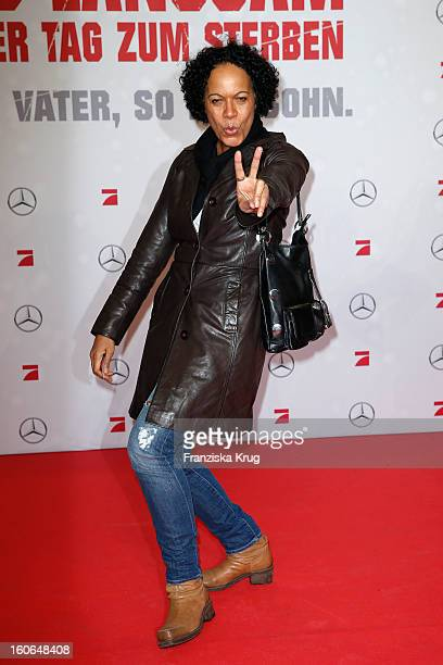 Mo Asumang attends the German premiere of 'Die Hard Ein Guter Tag Zum Sterben' at the cinestar Potsdamer Platz on February 4 2013 in Berlin Germany
