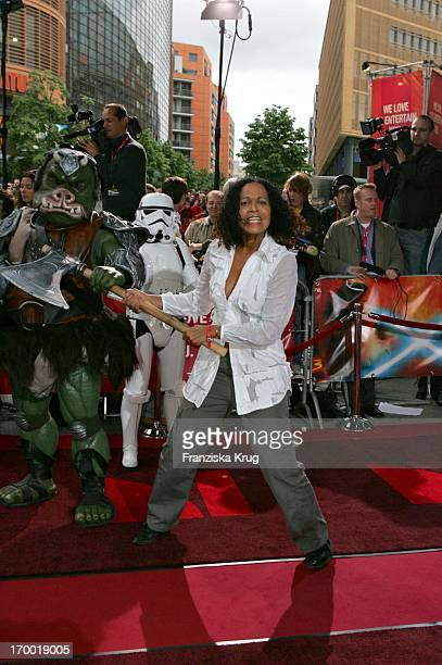 Mo Asumang With A Star Wars figure at the Germany premiere of Star Wars Episode Iii Revenge of the Sith In the theater at Potsdamer Platz in Berlin