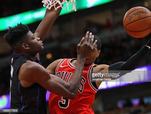 Mo Bamba of the Orlando Magic hits Shaquille Harrison of the Chicago Bulls in the face during their game at United Center on December 21 2018 in...