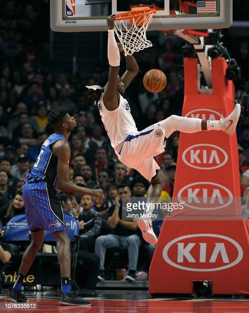 Mo Bamba of the Orlando Magic looks on as Montrezl Harrell of the LA Clippers dunks the ball in the fist half at Staples Center on January 6 2019 in...