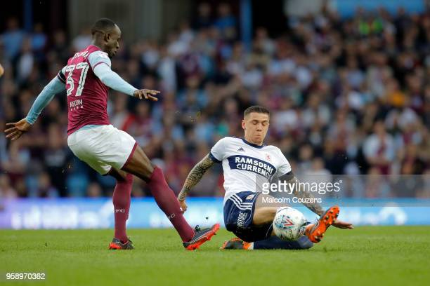 Mo Besic of Middlesbrough tackles Albert Adomah of Aston Villa during the Sky Bet Championship Play Off Semi FinalSecond Leg match between Aston...