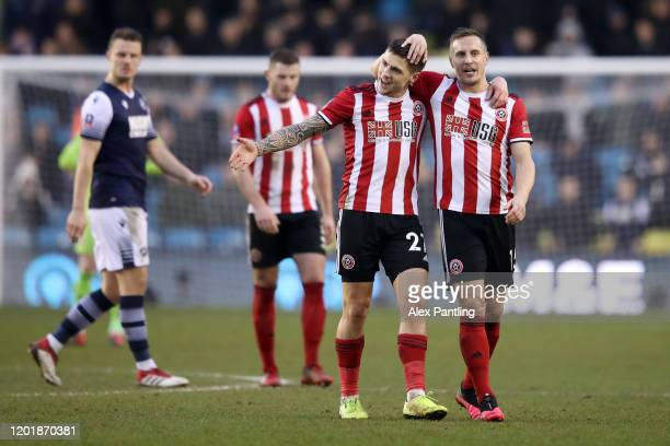 Mo Besic of Sheffield United celebrates with teammate Phil Jagielka after scoring his team's first goal during the FA Cup Fourth Round match between...