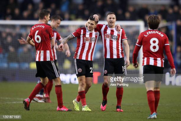 Mo Besic of Sheffield United celebrates with teammates after scoring his team's first goal during the FA Cup Fourth Round match between Millwall FC...