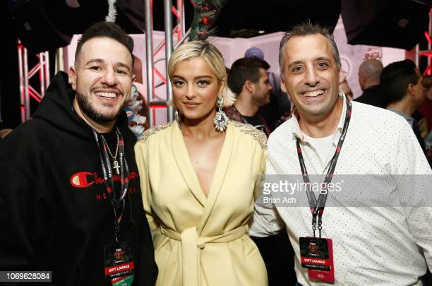 Mo' Bounce Bebe Rexha and Joe Gatto attend the Z100's Jingle Ball 2018 Gift Lounge at Madison Square Garden on December 7 2018 in New York City
