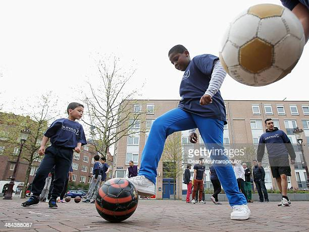 Mo Boutaka speaks to his players or students during the Laureus PannAcademy Visit held at Boerhaaveplein on April 12 2014 in Amsterdam Netherlands