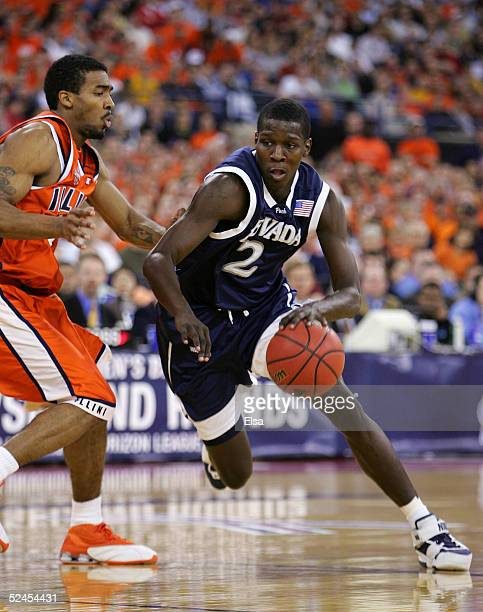 Mo Charlo of the Nevada Wolf Pack drives against Luther Head of the Illinois Fighting Illini in the second round game of the NCAA Division I Men's...